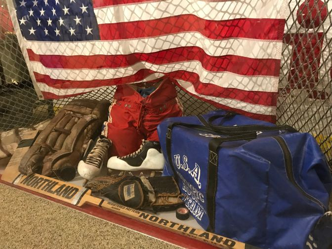 Goaltending equipment of Jim Craig, along with a net and a US flag from the game.