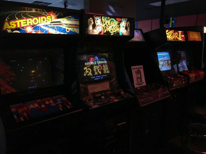 Video game machines, including Asteroids, Double Dragon, and Street Fighter 2.