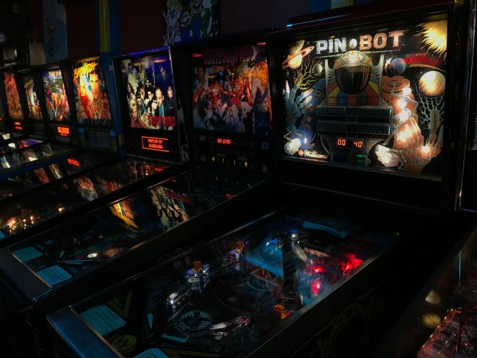 A row of pinball machines.