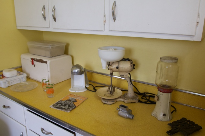 Countertop in kitchen, with old mixer and blender.