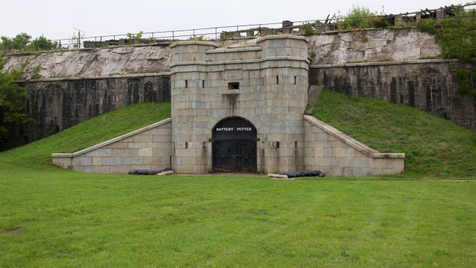 Stone entrance to Battery Potter, with the fortifications behind it.