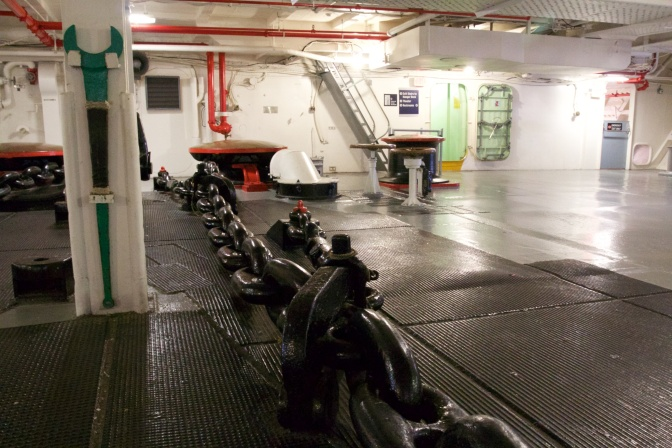 View of the anchor room, with one of the large anchor chains in the middle.