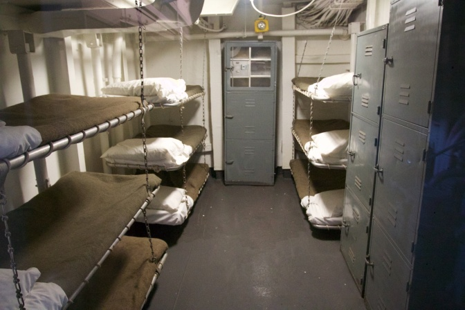 Enlisted personnel bunks. There are 9 bunks and two lockers visible in the photo.