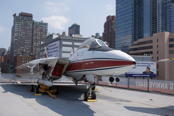 F-14D Tomcat, on carrier deck, with the New York Skyline behind it.