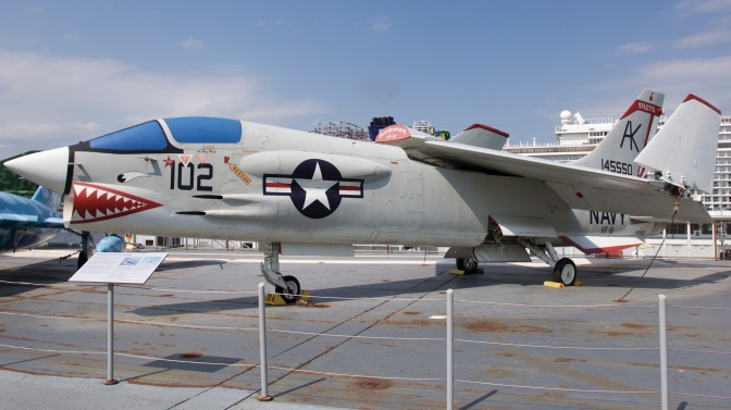 Vought F-8 Crusader on carrier deck.