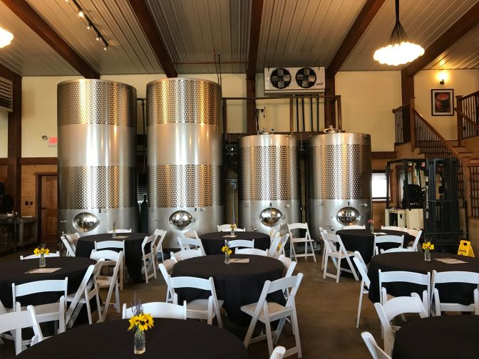 Stainless steel metal aging drums in tasting room.