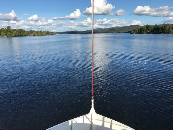 View of the bow of the WW Durant, with Raquette Lake beyond it.