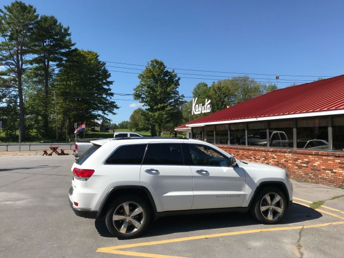 2014 Jeep Grand Cherokee in the foreground, with Kayuta ice cream in the background.
