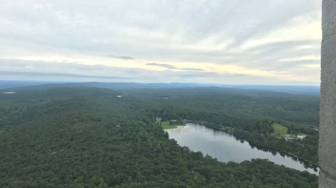Vista from the top of the monument. A lake is in the foreground.
