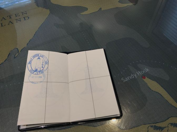 Lighthouse Passport Book on top of map of NJ Lighthouses.