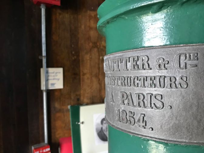 Metal plaque on cupola of lighthouse that indicates construction in Paris in 1854.