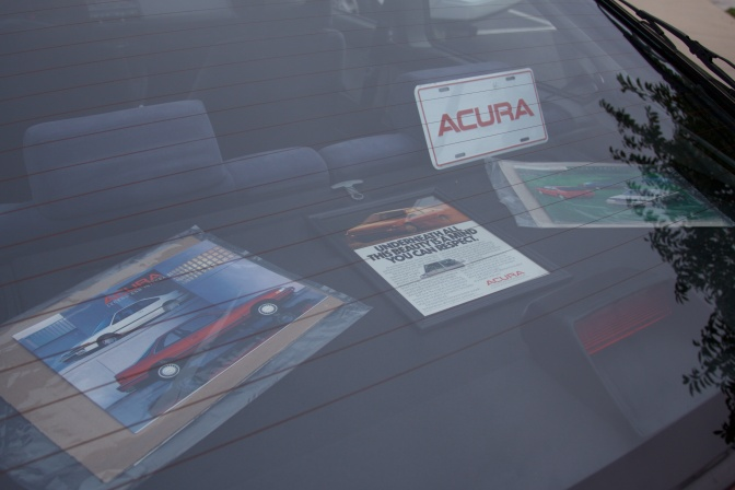 Display of promotional material on deck lid of Acura Integra trunk.