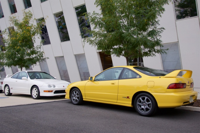 White Acura Integra Type R parked next to yellow Acura Integra Type R.