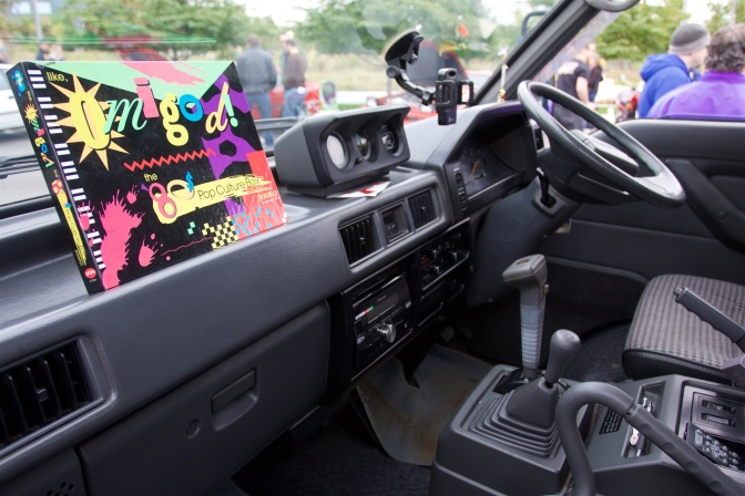 Dashboard of Mitsubishi Delica. The steering wheel is on the right of the dashboard.