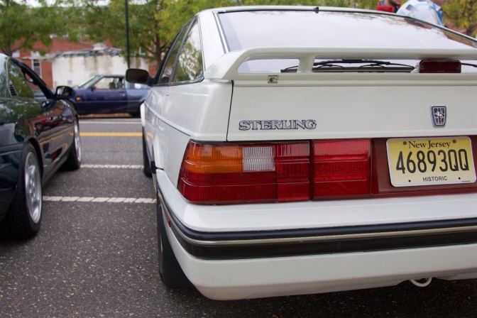 Rear view of white Sterling 827i sedan.