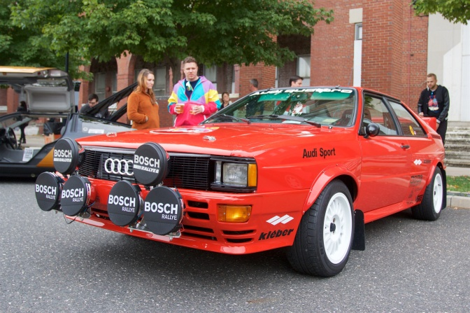Red Audi Quattro with rally lights on the front.