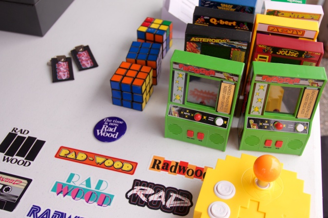 Souvenir stand including Rad-Wood stickers, Rubik's cubes, and miniature video games.