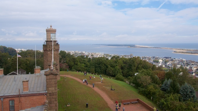 Vista from the top of the South Tower. The North Tower is in the foreground, and Sandy Hook bay is in the distance.