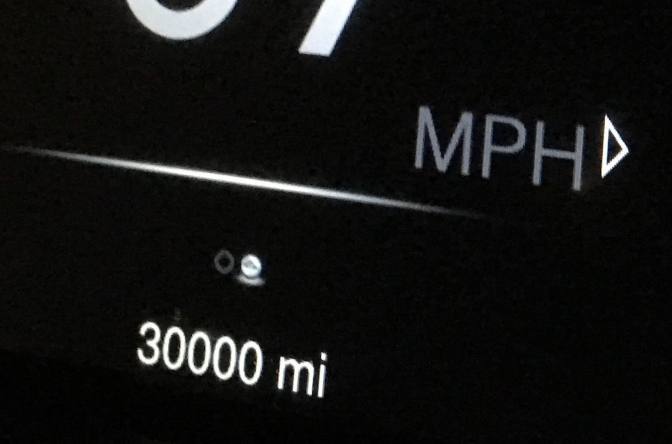 Car odometer reading 30,000 miles.