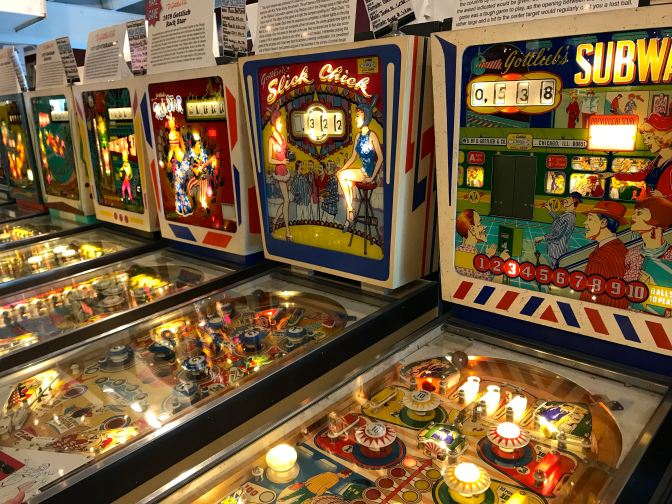 Row of classic pinball machines including SUBWAY and SLICK CHICK.