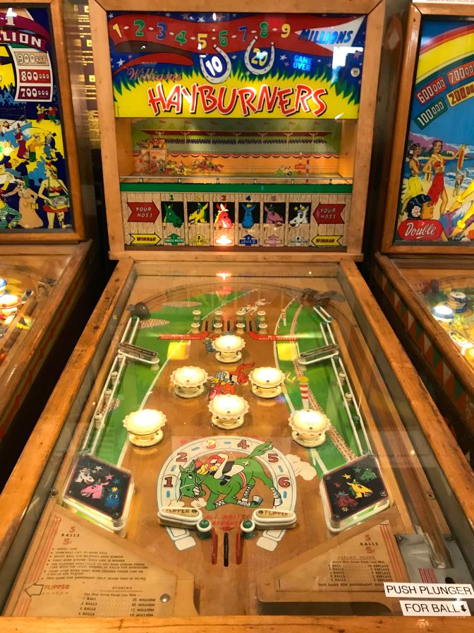 Hayburners by Williams pinball machine. The machine has a mechanical racetrack on the scoreboard.