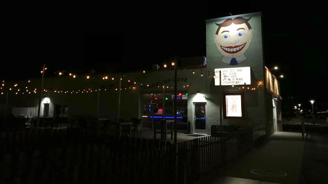 Wonderbar at night, with painting of Tillie on the side of the building.
