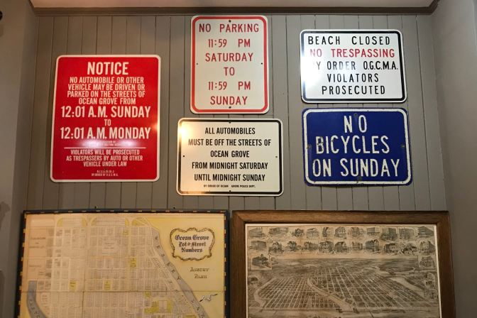 Signs declaring that beaches are closed and driving is forbidden during Sundays.
