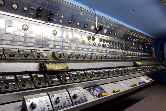 Switchboard controlling trains, which fills a 30-foot long wall in a  room.