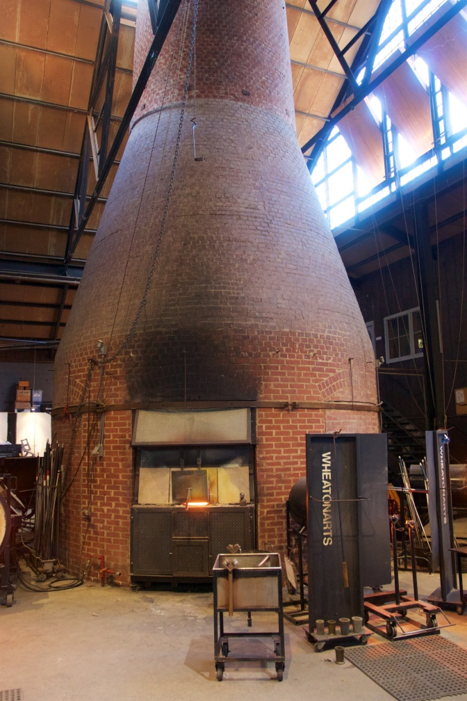 WheatonArts oven. Made from brick, one of the openings into the oven is visible.
