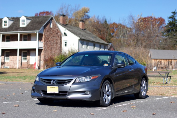 2012 Honda Accord coupe in front of historic buildings.