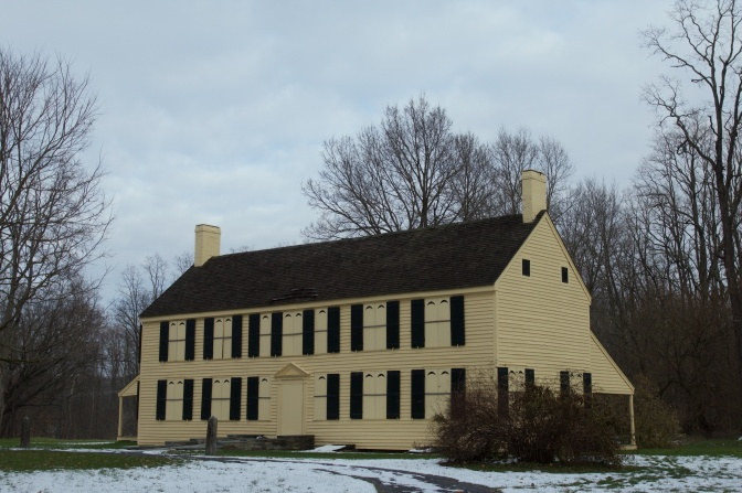 Exterior of the Schuyler House, a yellow two story clapboard house.