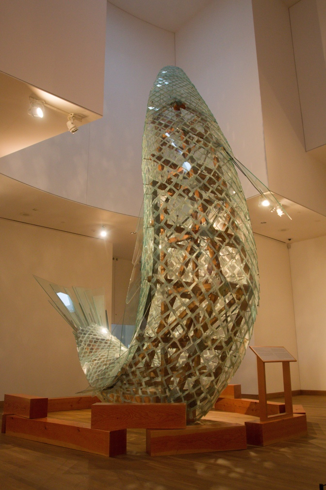 Standing Glass Fish art exhibit in the museum.