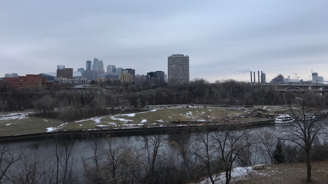View of the skyline of Minneapolis, with the Mississippi River in the background.
