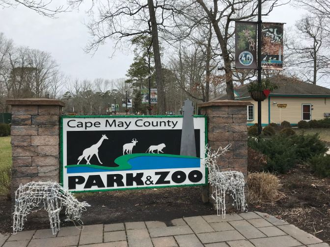 Entrance to Cape May Zoo. A sign says CAPE MAY COUNTY PARK & ZOO.