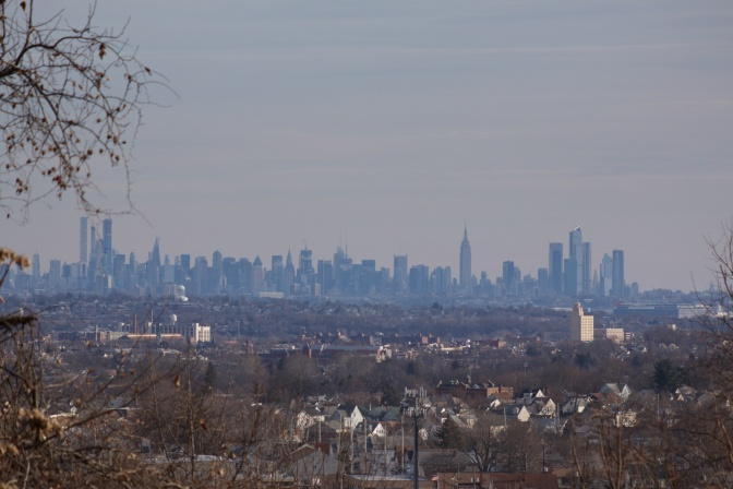 View of Paterson, NJ with skyline of Manhattan in the distance.