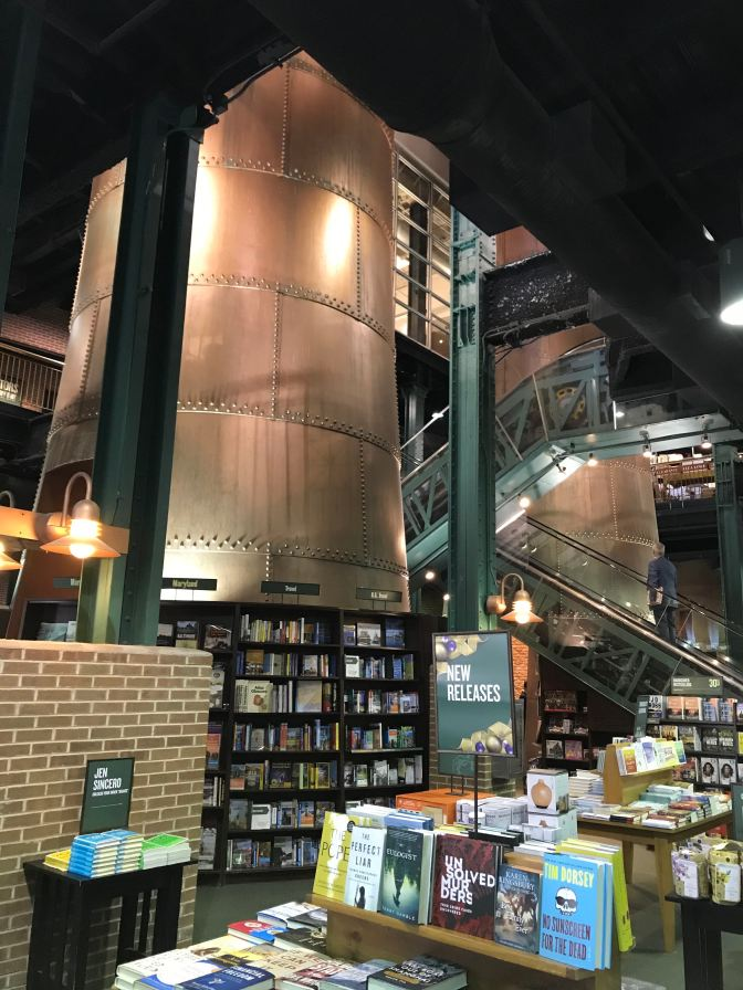 Interior of Barnes and Noble, with bookshelves in the foreground and boilers in the background.