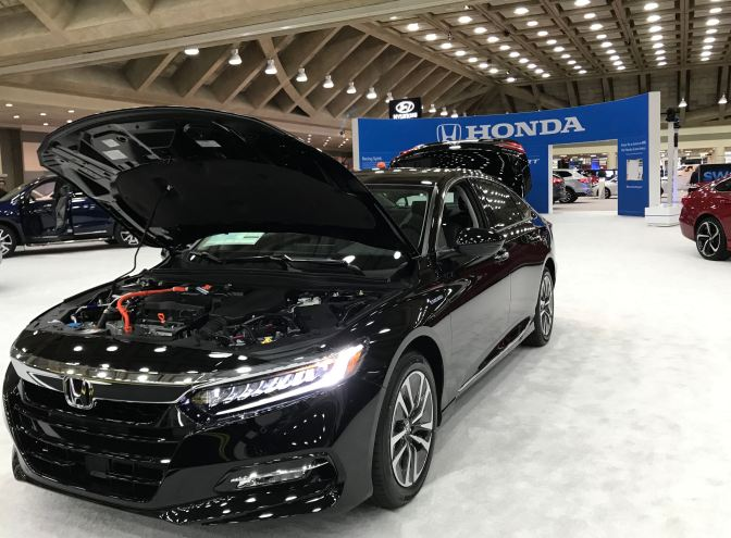 2019 Honda Accord, in black, with its hood up.