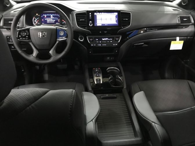 Interior of Passport, with view of front seats and dashboard.