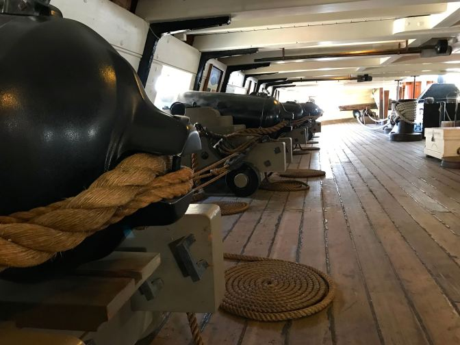 Gun deck, with four cannons pictured.