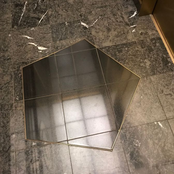 Pentagon-shaped design in elevator floor.