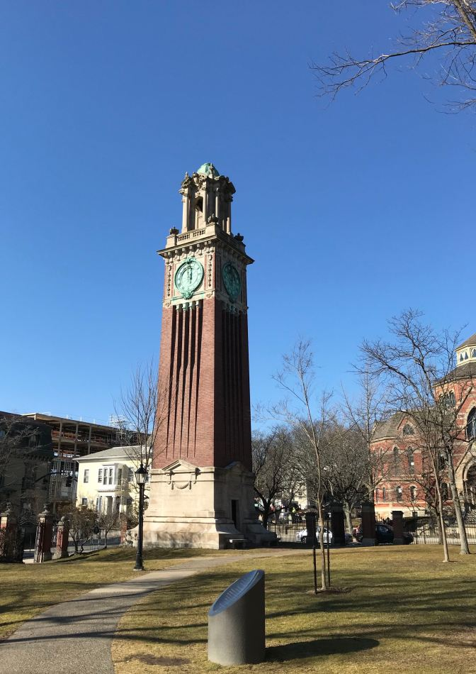 Carrie Tower, a brick and marble clock tower.
