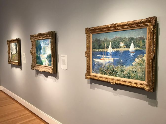 Three paintings by Monet.