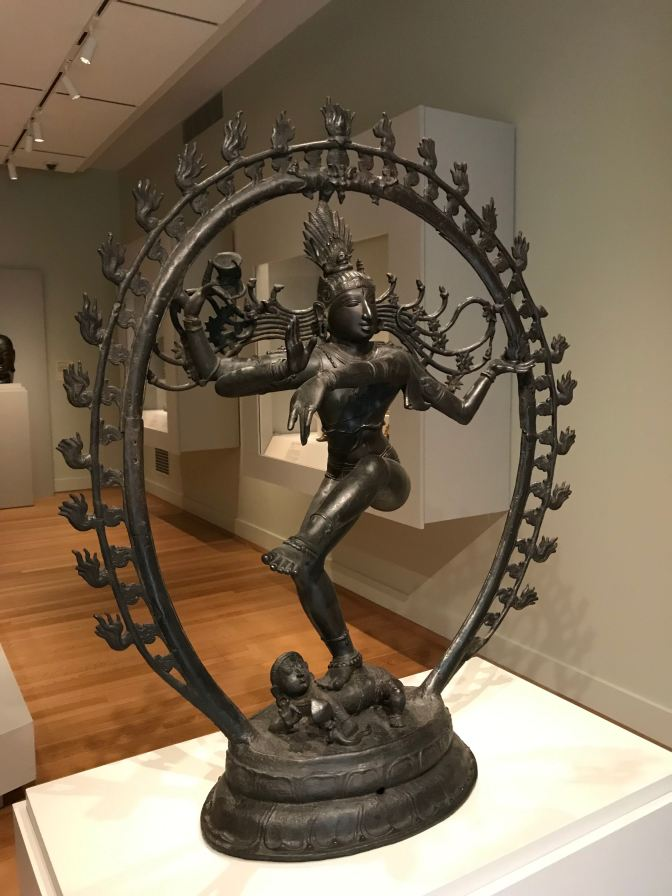 Statute of Shiva Nataraja, surrounded by a wire hoop with flames emanating from it.