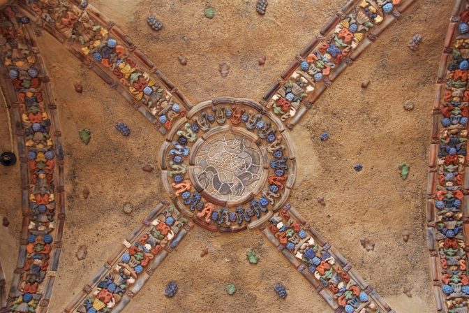 Tile mosaic in the vaulted ceiling.