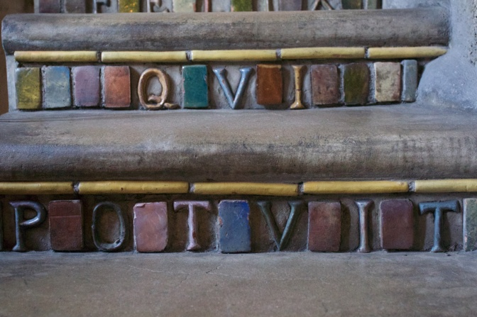 Tilework Latin inscription, on stairs.