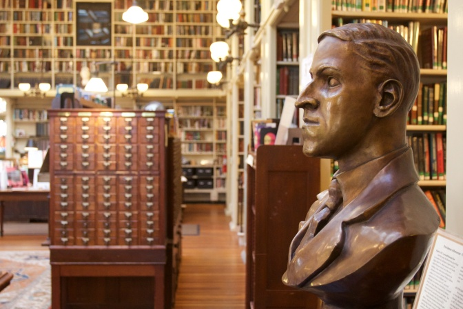 Bronze bust of HP Lovecraft in the main hall of the library. The card catalog is in the background.