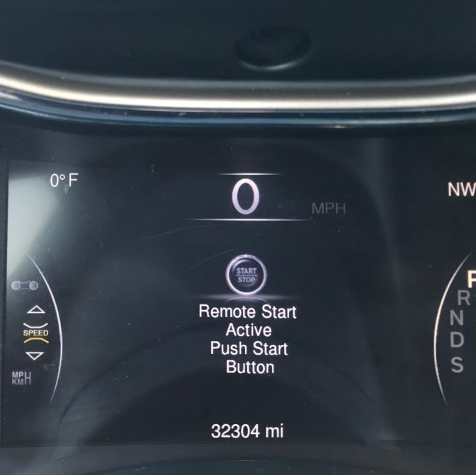 Dashboard display of car that reads REMOTE START ACTIVE PUSH BUTTON START 32304 MI. Temperature display reads 0 degrees.