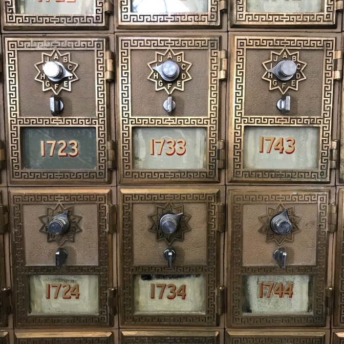 Metal and brass post office boxes with numbers 1723 1733 1743 1724 1734 1744