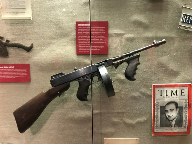 Tommy Gun, mounted on wall in display case.