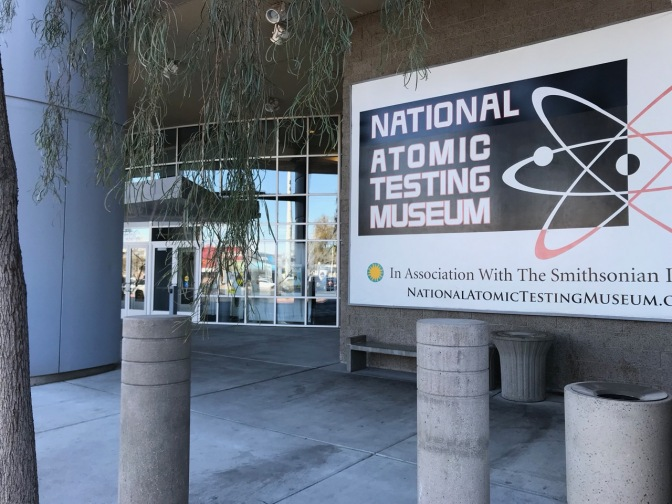 Entrance to National Atomic Testing Museum, with a large sign with the museum's name by the entrance.